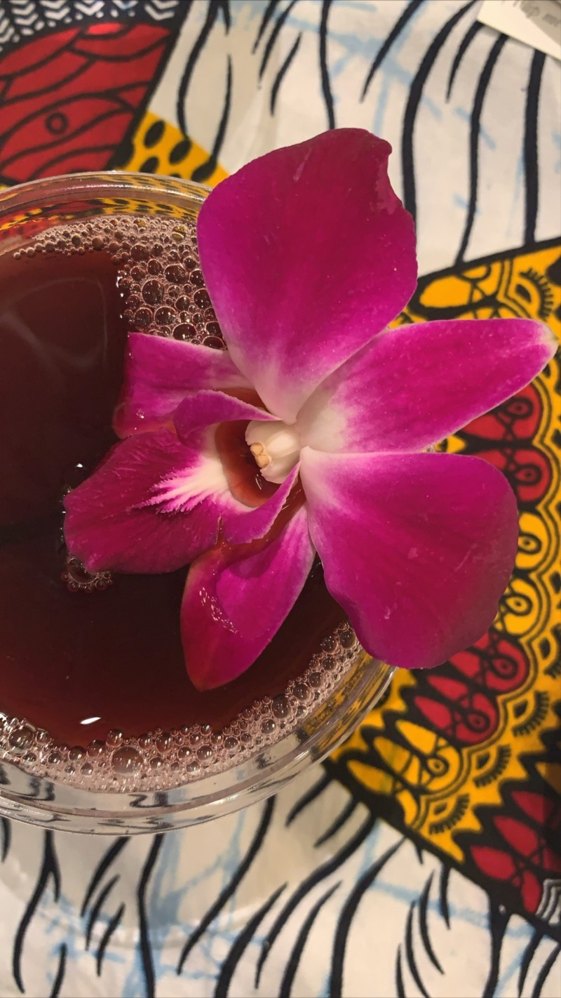 Cocktail with pink flower